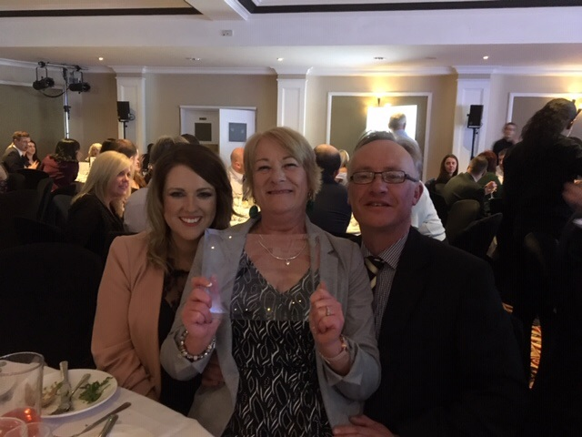 An image of three Shropshire Towns and Rural Housing staff with the award for Best Project 2019.