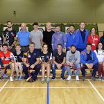 This is an image of Shropshire Armed Forces Covenant partners in a sports hall with Armed Forces veterans and coaches of the Battle Back Centre