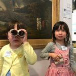 An image of two children in front on a painting at Shrewsbury Museum and Art Gallery with cardboard binoculars ahead of the free entry for children promotion.