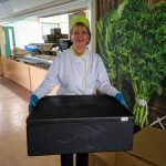 Claire Downing, Column Restaurant manager with a box of hot lunches ready for distribution.