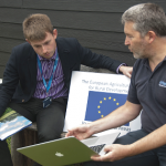 An image of Shropshire Councillor Elliott Lynch being briefed by the Director of Airband about the superfast broadband provision in the Shropshire Council area.