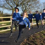 Criftins pupils go for a run on the school's new running track