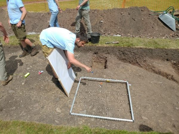 An image of the trench being drawn and recorded at the first ever excavation of Shrewsbury Castle.