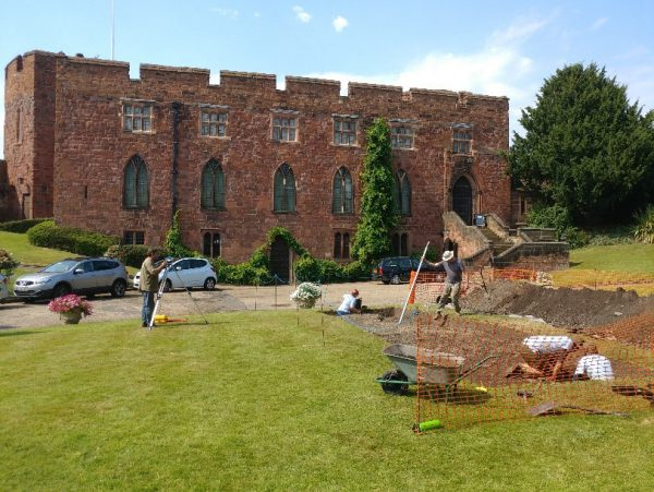 An image of the dig taking place at Shrewsbury Castle on a sunny day with Shrewsbury Castle standing proudly in the background.