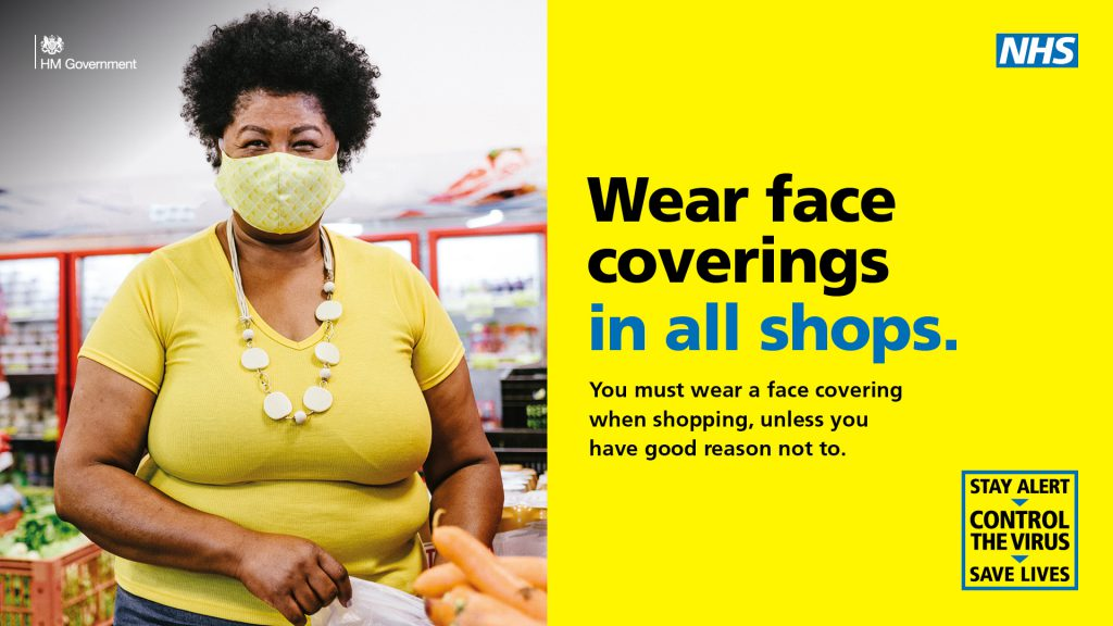 An image of a lady wearing a face covering in a shop.