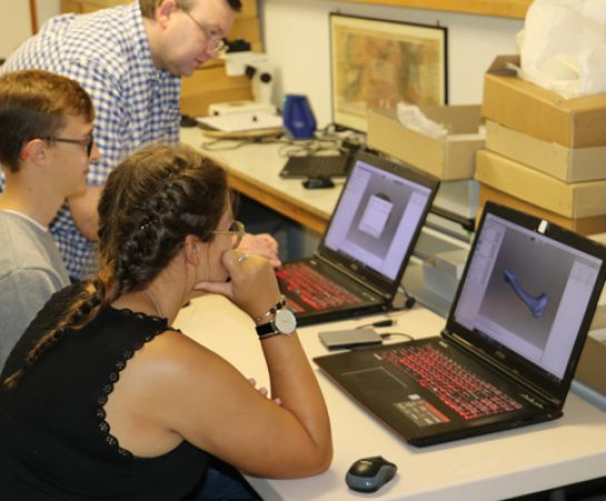 An image of volunteers digitising collections with the Fossils in Shropshire project.