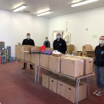 An image of Shropshire Council staff preparing food parcels to be delivered to vulnerable Shropshire residents impacted by coronavirus.