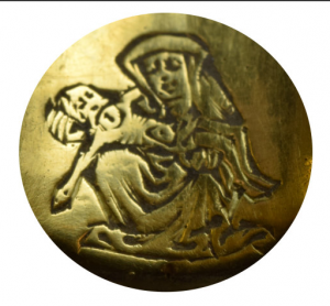 An image of engraving in the gold signet ring found in Shropshire that has been declared as treasure.