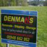 This is a picture of a sign advertising Denmans, a new garss cutting sponsor in Whitchurch.