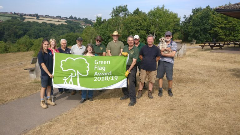 An image of staff and volunteers at Severn Valley Country Park celebrating the Park being awarded the Green Flag.