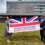 An image of Shropshire Council's interim acting chief executives standing 2m apart holding the Armed Forces Day flag.