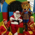 Lenny the Lion with Santa and his elves in the Darwin Centre grotto