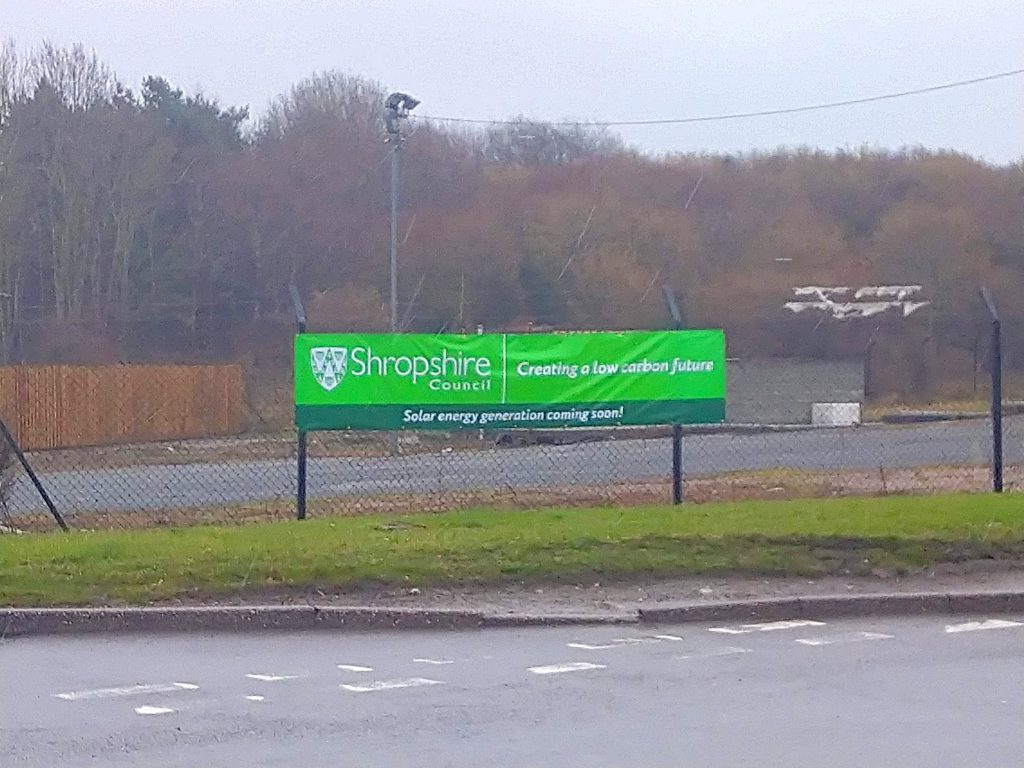 A banner at the solar array site in Oswestry
