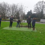 An image of the Oak Tree being planted in memory of Percy Mullaly.