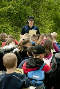 An image of a ranger at Severn Valley Country Park about to lead a group of children on the mini woodland beasts session.