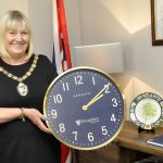 Councillor Ann Hartley, Chairman of Shropshire Council, with the Newgate clock