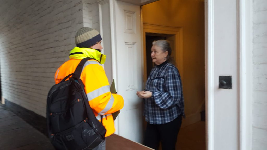An image of a Shropshire Council officer offering support to a resident affected by the floods caused by Storm Dennis