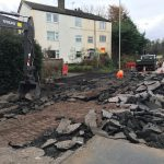 The damage to the A4117 at Rocks Green caused by a burst water main