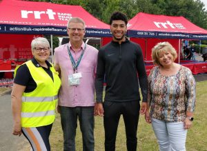 An image of Shrewsbury Town Football Club's Josh Laurent with representatives of SaTH at the NHS charity fun day.