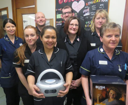 Staff from Pharmacy and EOLC with the CD players