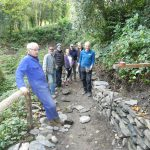 Enthusiastic team of dry stone wallers at Plas Newydd