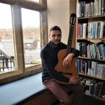 An image of Jules Morgan with his acoustic guitar. He will be performing in the first Darwin Room Sessions event at Shrewsbury Library.