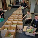 Food parcels being readied for taking to homes of the most vulnerable. Pete Banford is furthest to the right of the photo.