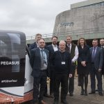 Councillors and council officers with a Westfield 'pod car' outside Shirehall