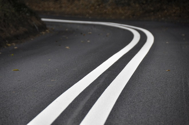 A raod with markings ( a road bends)